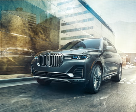 Black BMW X7 Driving in City