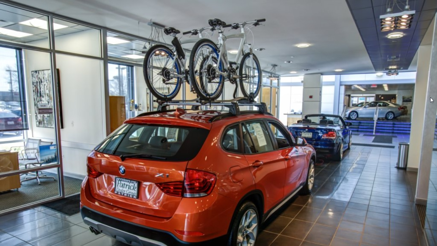 a new BMW SUV in the showroom at Patrick BMW