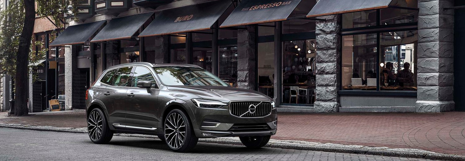 2018 Volvo XC60 parked in front of store fronts