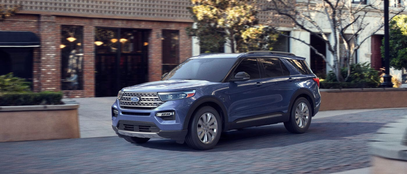 2020 Ford Explorer driving down the street