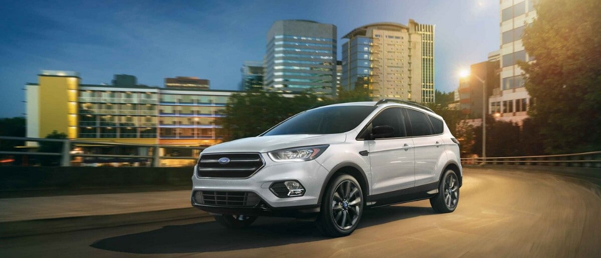 2019 Ford Escape driving out of city in the evening