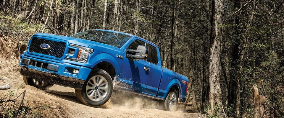 2018 Ford F-150 STX driving on a rocky road