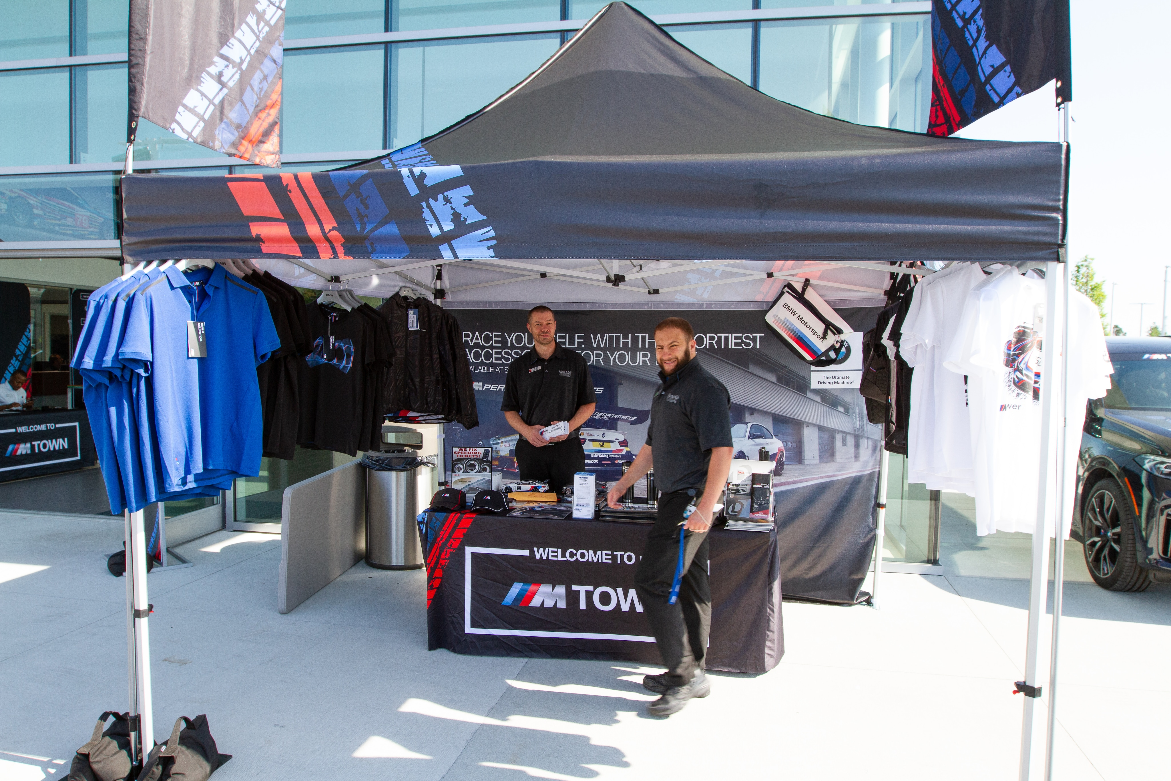 Assistant Parts Manager Keith Alger and Accessories Specialist Drew Levat showcase M Performance parts and gear at M Town Tour tent.