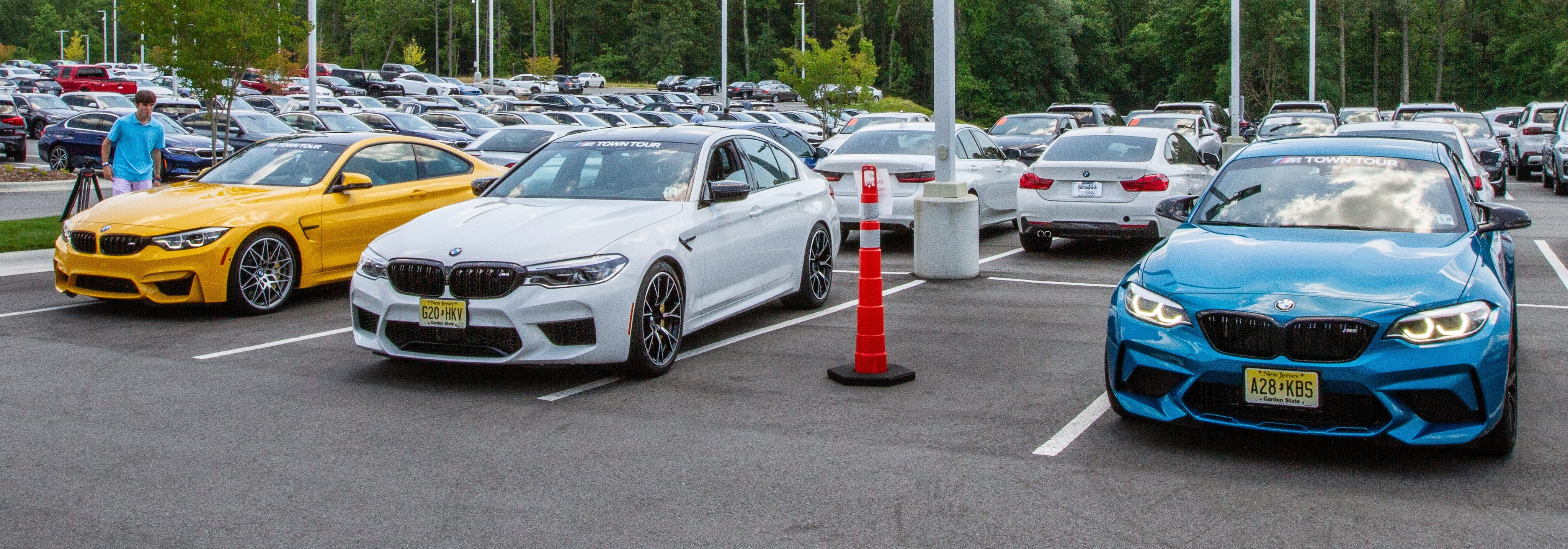BMW Austin Yellow M4, white M5 Competition, and M2 Competition ready to drive at BMW of Southpoint's M Town Tour.