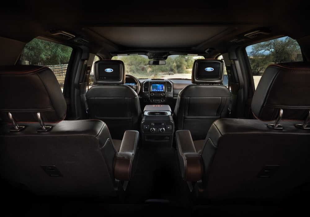 2020 Ford Expedition King Ranch interior design view from the 3rd row showing 7 seats and mounted TV displays