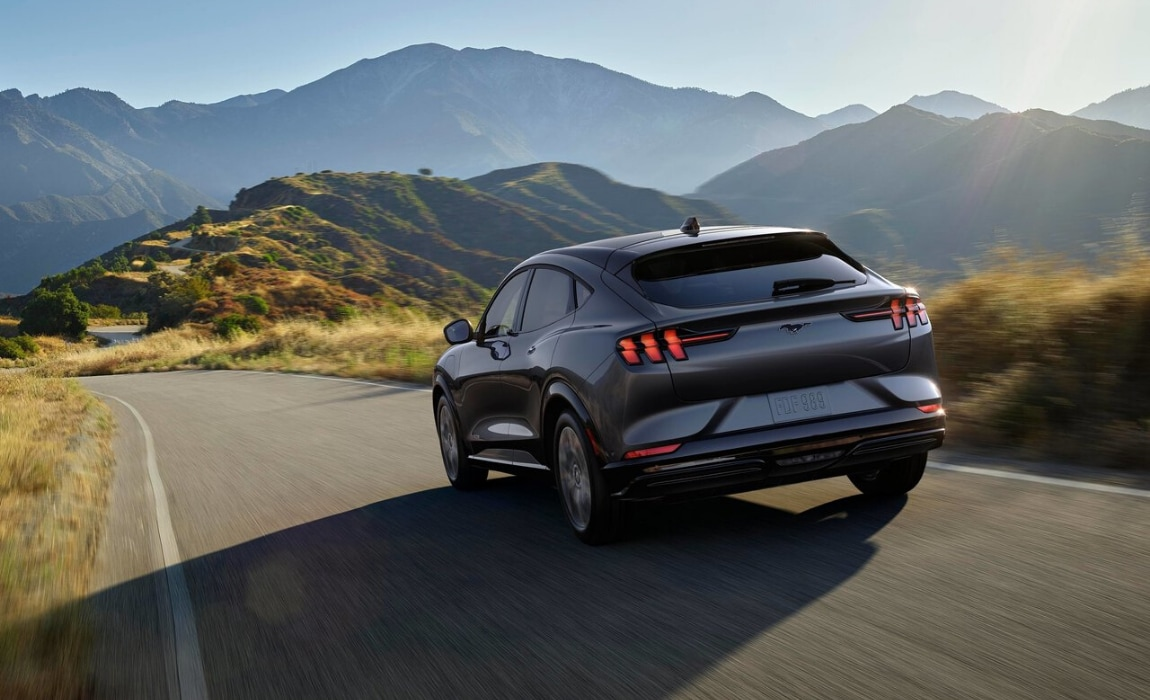 2021 Ford Mustang Mach-E exterior gray color driving through mountains