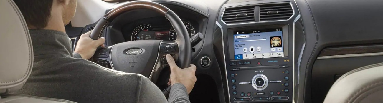A look at the interior of a 2019 Ford Explorer in Colorado Springs from the back seat as the driver adjusts Sony radio from the steering wheel
