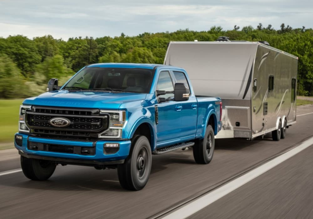 2020 Ford F-250 Super Duty blue exterior color towing a large trailer