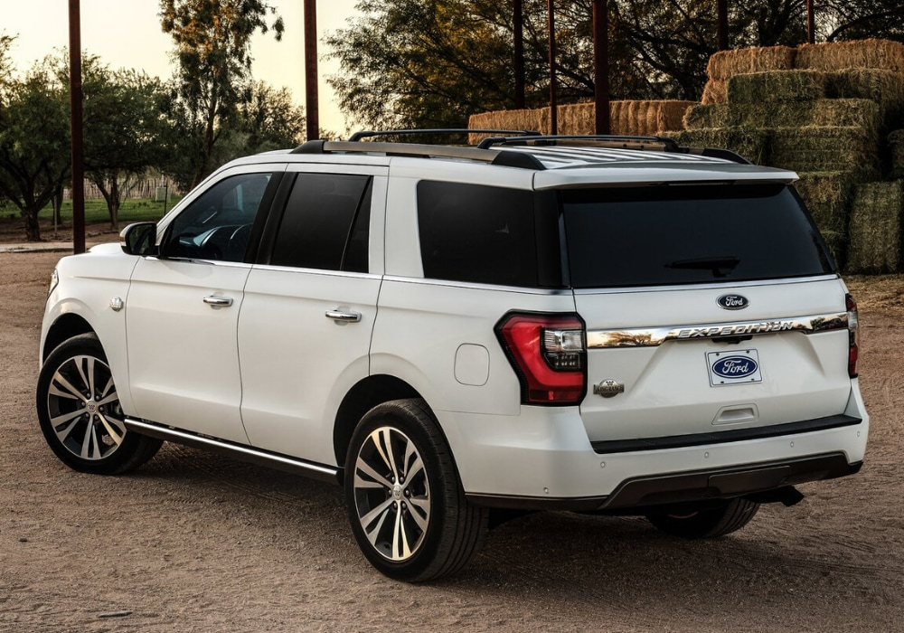 2020 Ford Expedition exterior rear view in white color parked by bales of hay on a farm