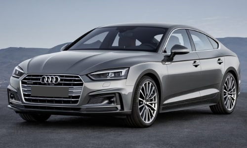 2020 Audi A5 sportback dark gray parked misty mountain cliff scene