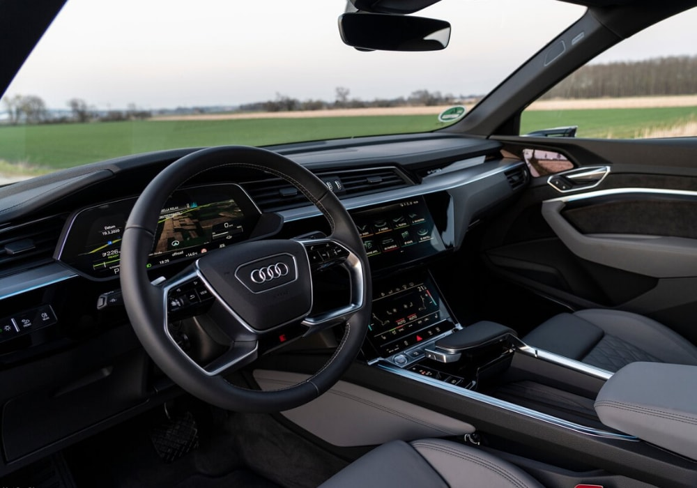 Interior design of the 2020 Audi e-tron Sportback seen through the driver window from outside the car