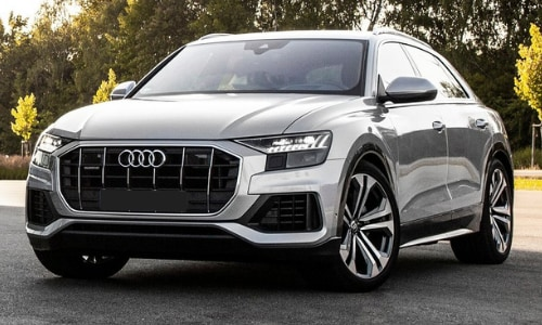 2020 Audi Q8 silver parked by other 2020 audi models