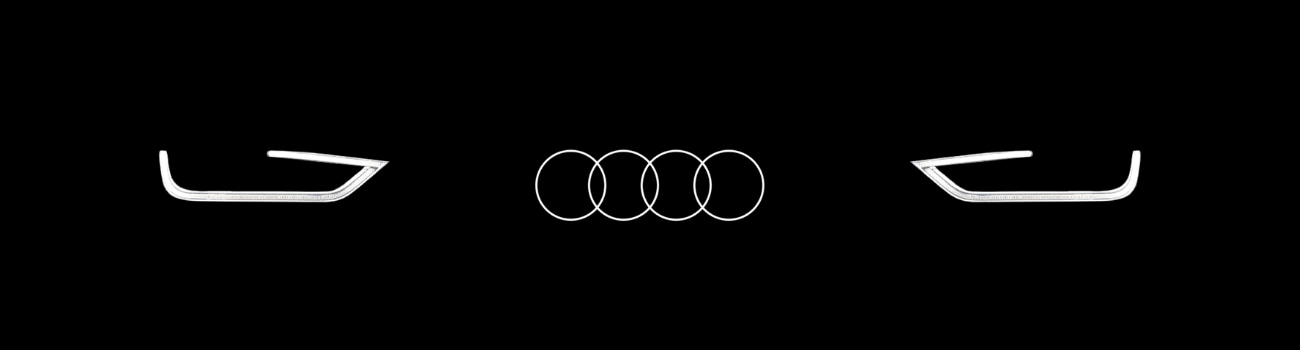 Vector image of the outline of Audi headlights with an Audi logo in the middle