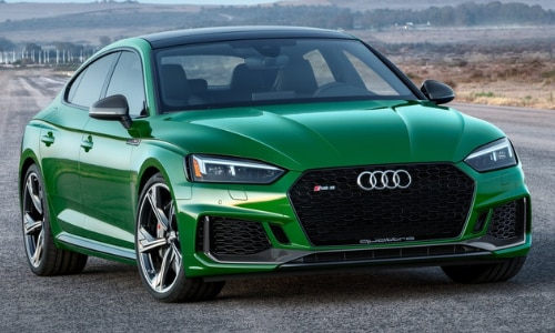 2020 Audi RS 5 green still shot abandoned air strip forest