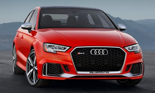 2020 Audi RS 3 parked atop a concrete overlook mountain range