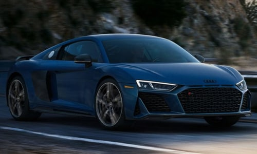2020 Audi R8 coupe blue handling a sharp mountain road curve a high speed