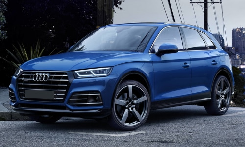 2020 Audi Q5 blue turning street corner downtown