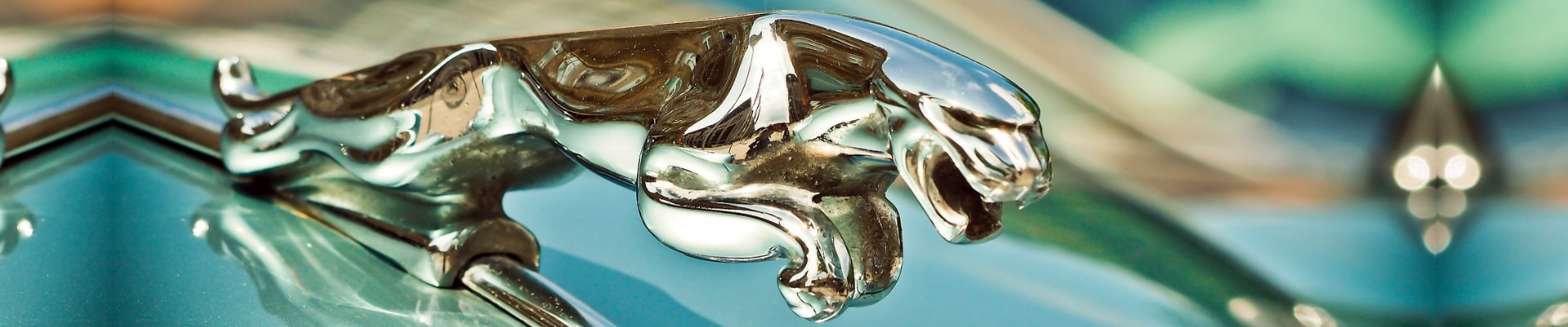 Zoomed in camera angle of the Jaguar Emblem mounted ton the hood of a used Jaguar car