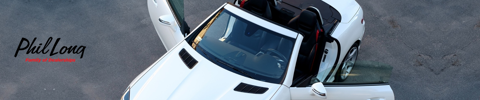 Bird eye view of a white used luxury car with both doors open inspecting the interior condition of the car