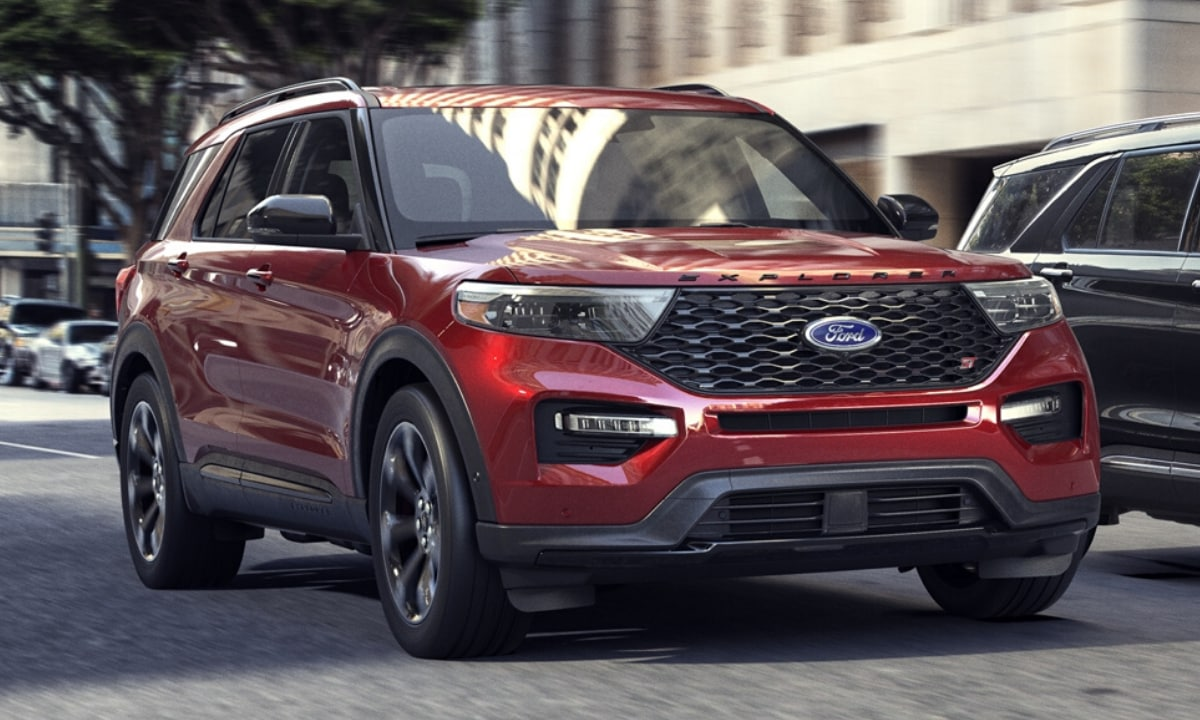 New Ford Explorer ST model in red and black colors driving beside a Ford Explorer Platinum trim