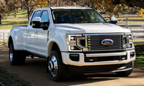 2020 Ford Super Duty front exterior white limited trim farm road