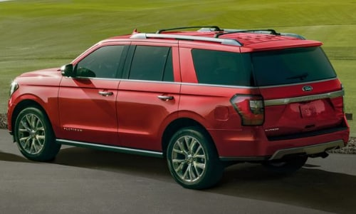 2020 Ford Expedition red parked asphalt green golf course