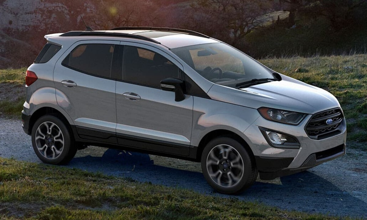 New Ford EcoSport in silver color driving down a rocky path through the mountains