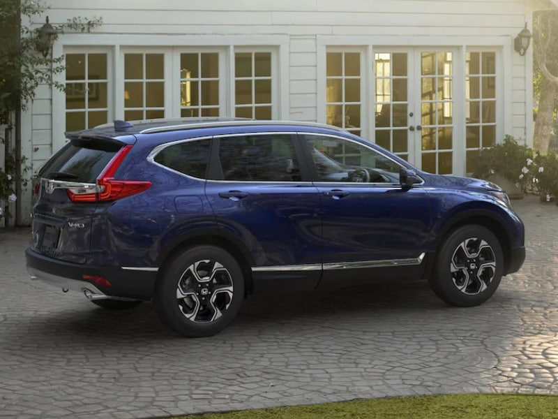 Exterior of a blue 2019 Honda CR-V parked in a driveway