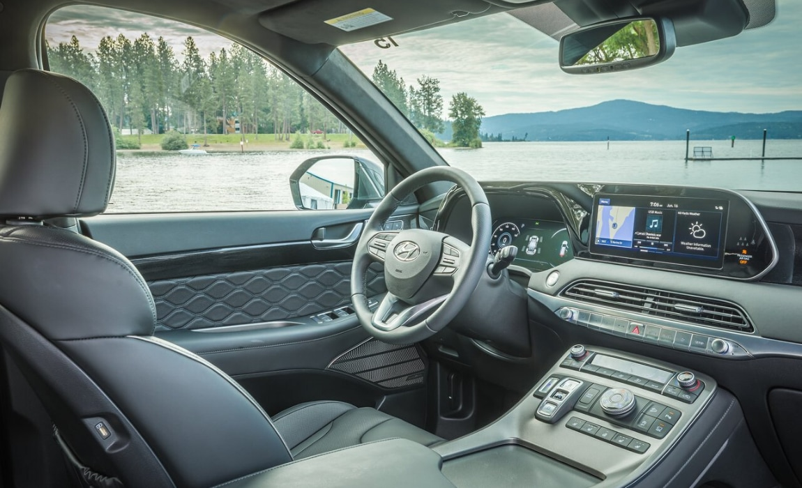 Classy interior front cabin inside the 2020 Hyundai Palisade Limited showing a clean look and tech focus