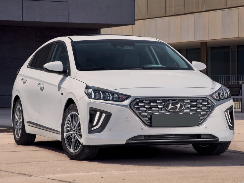 2020 Hyundai Ioniq hybrid / electric car white color parked modern industrial scene