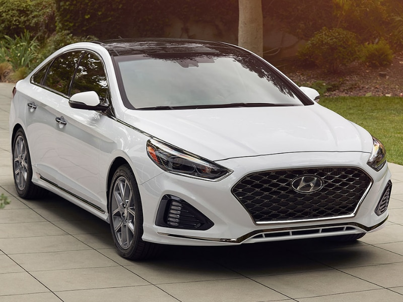 Exterior of a white 2019 Hyundai Sonata parked in a driveway