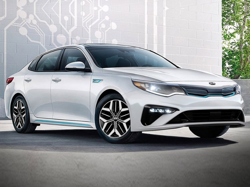 2020 Kia Optima plug-in hybrid parked in a garage unplugged from charging port