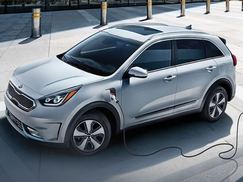 2020 Kia Niro plug-in hybrid plugged into a charging station
