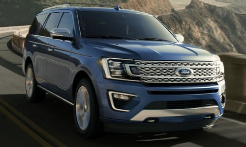 2020 Ford Expedition blue driving in-motion bridge mountain pass