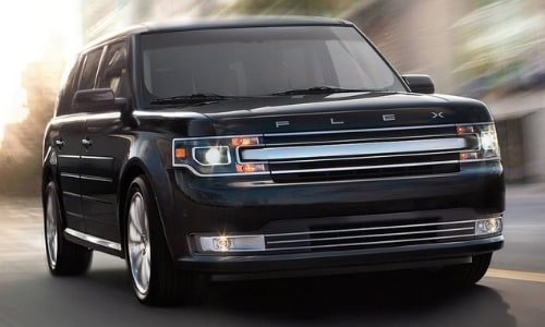 2020 Ford Flex black fast motion shot city street blurry backdrop