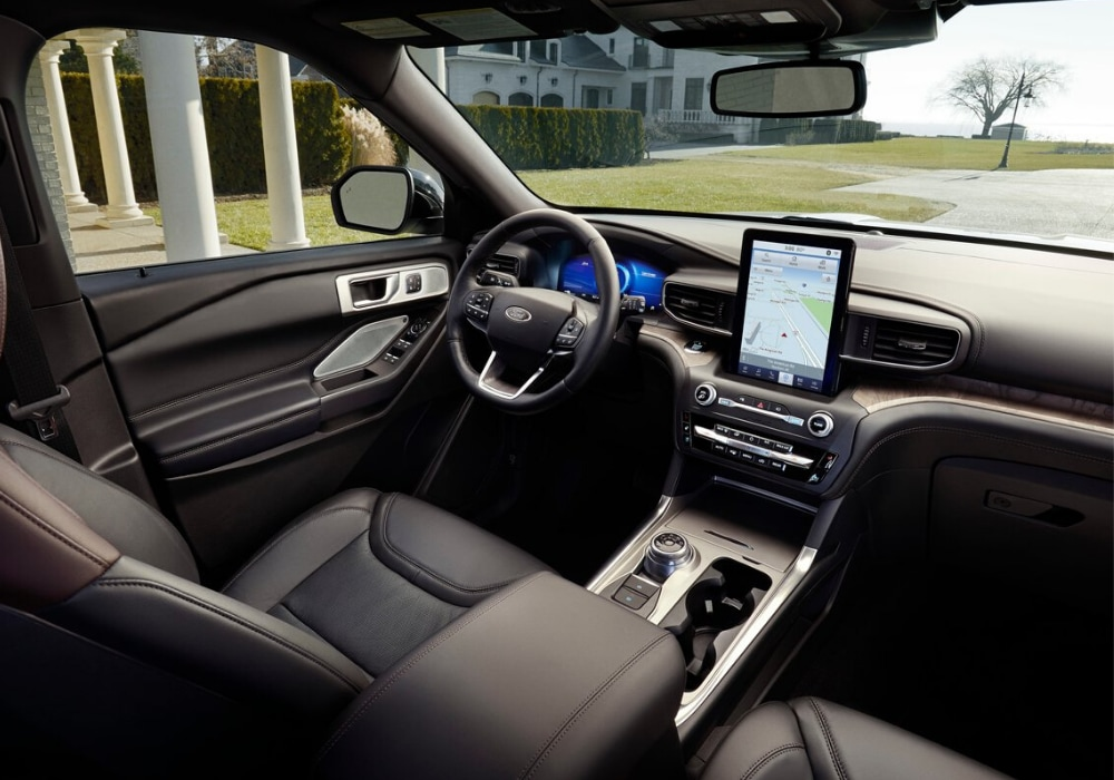 Interior front cabin of the 2020 Ford Explorer Platinum from the view of the 2nd-row seats