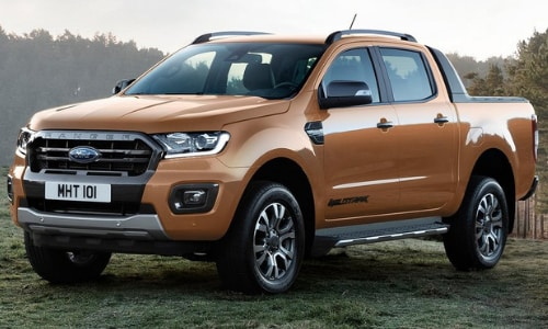 2020 Ford Ranger Wildtrak orange grassy knoll forest sunset
