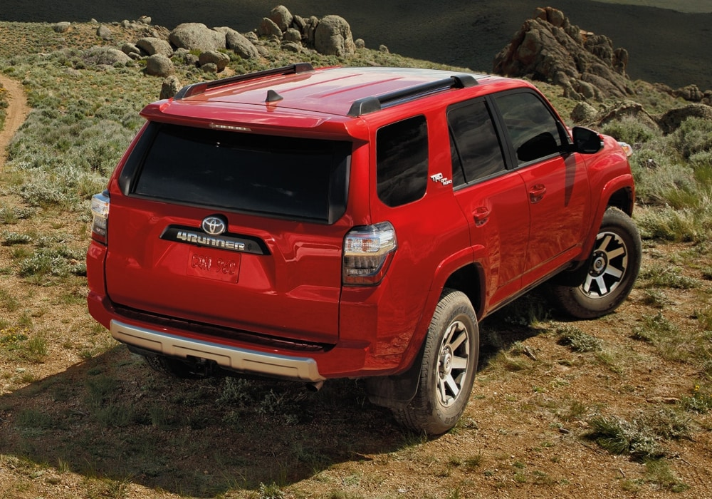 2020 Toyota 4Runner TRD Off-Road parked near a hill cliff in red exterior color