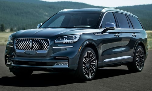 2020 Lincoln Aviator parked open asphalt slab forest background