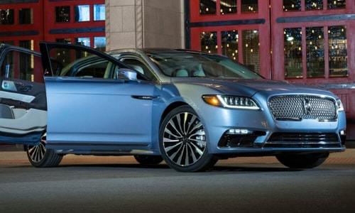 2020 Lincoln Continental blue parked suicide doors open large red garage doors