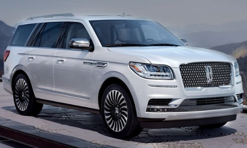2020 Lincoln Navigator Black Label white parked outside house cobblestone driveway mountain overlook