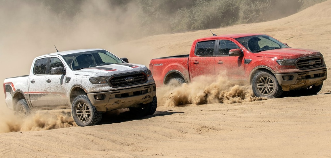 New 2021 Ford Ranger Tremor trucks racing side by side off-road in thick sand