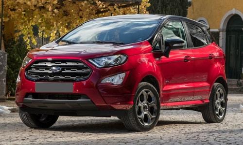 2020 Ford EcoSport red black roof parked driveway autumn leaves