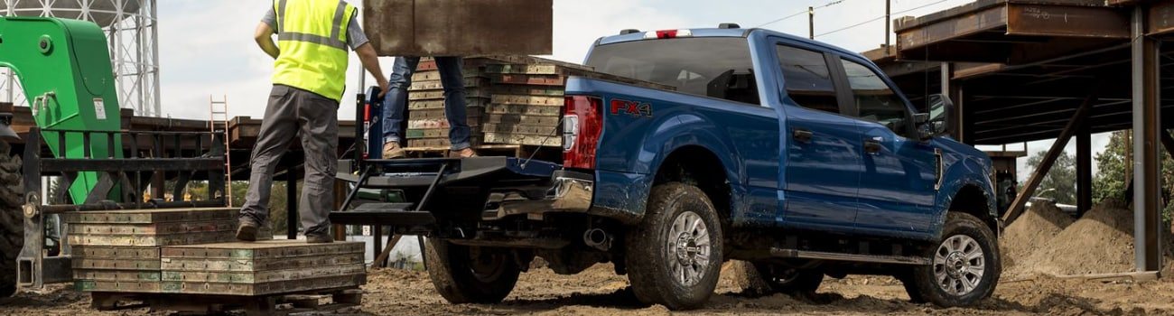 2020 Ford Super Duty hauling loads of cut lumber showing payload performance construction site