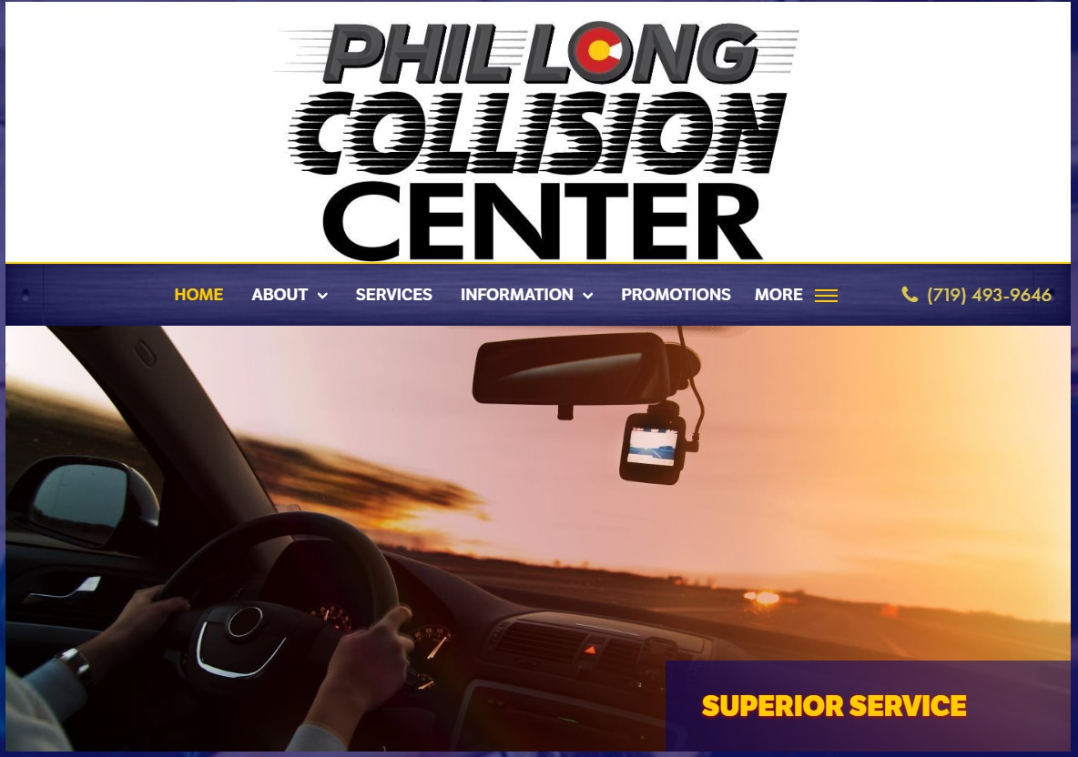 Screenshot of the homepage of the Phil Long Collision Center in Colorado Springs