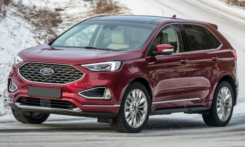 2020 Ford Edge red in-motion curvy mountain highway snow