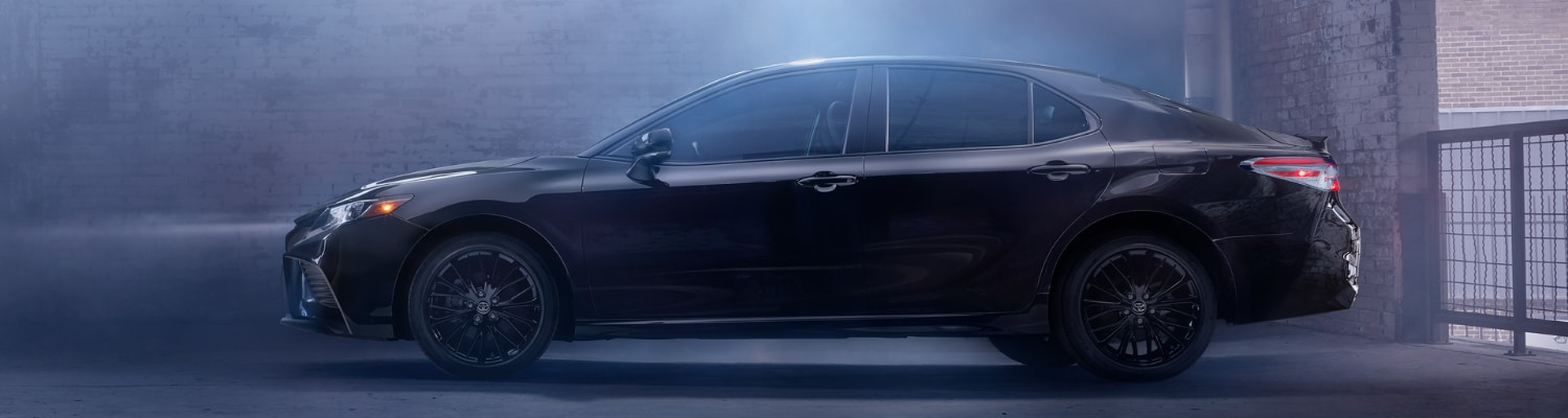 2019 Toyota Camry black exterior color side angle