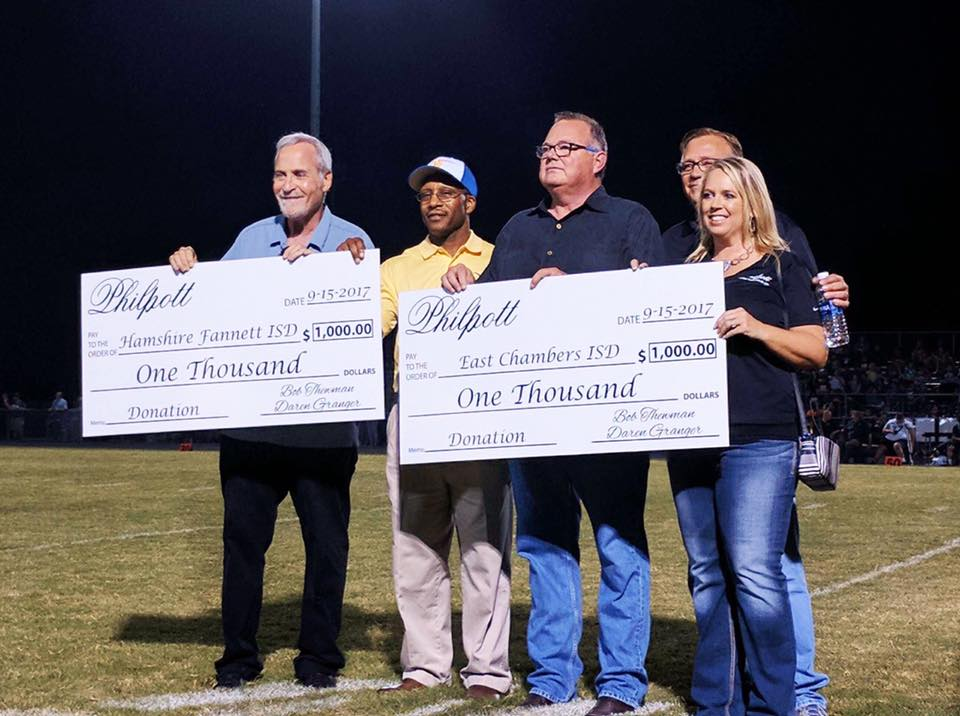 Philpott presents checks to Hamshire Fannett ISD and East Chambers ISD