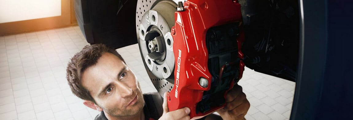 Porsche technician performing a brake service