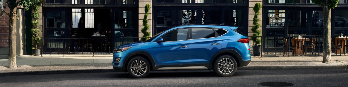 New Hyundai Tucson outside a storefront